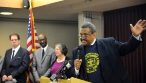 Tony Fugett, president of the Baltimore County branch of the NAACP, addresses the press conference. In the background from left are: Robert Strupp, executive director of Baltimore Neighborhoods Inc.; Victor Goode, with the national NAACP; and Susan Tannenbaum, Mistress of Ceremonies. (Baltimore Sun)