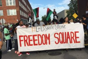 Chicago activists block the entrance to police facility Homan Square. Photo by Gillian Giles/BYP 100 Chicago