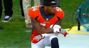 Brandon Marshall kneels during the national anthem at the NFL Kickoff game Thursday night