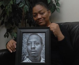 Venida Browder holds a photo of her late son, Kalief Browder, who committed suicide last year after serving time at Rikers Island. Image courtesy of SAM COSTANZA/FOR NEW YORK DAILY NEWS.