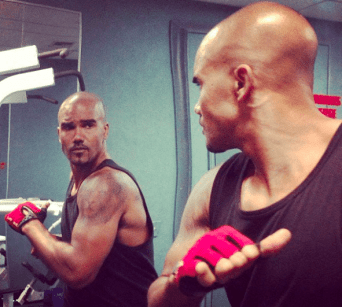 Shemar Moore checking himself out in the mirror as he works out.