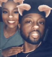 The Wades aren't afraid to keep things light with an Instagram filter and an old-school jam. (@gabunion/Instagram)