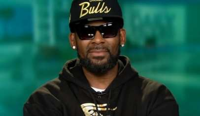 R. Kelly's former manager was issued an arrest warrant for threatening a parent of one of his accusers.