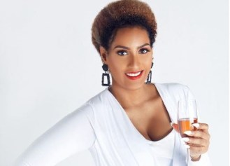 Juliet Ibrahim toasting champagne
