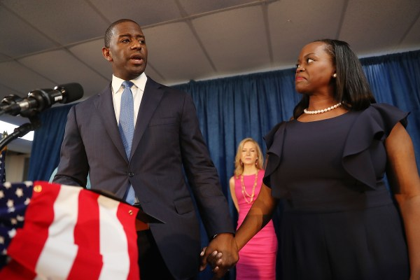 Then-gubernatorial candidate Andrew Gillum stands alongside his wife, R. Jai Gillum, as he speaks during a campaign rally at the International Union of Painters and Allied Trades in Orlando, Florida. (Photo by Joe Raedle/Getty Images)