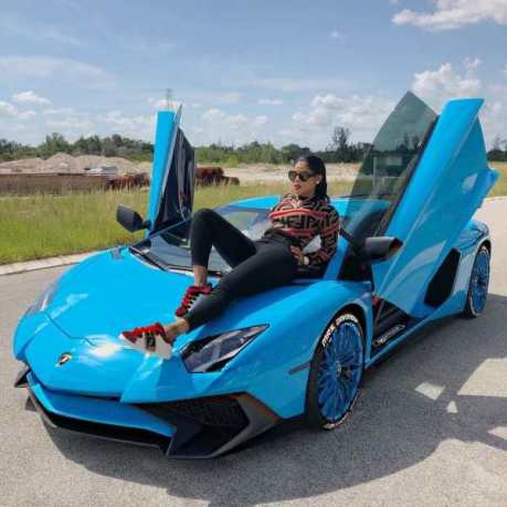 Keyshia Ka'oir poses on blue Lamborghini. @keyshiakaoirInstagram