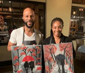 Common and Tiffany Haddish show off their paintings. Photo @tiffanyhaddish/IG