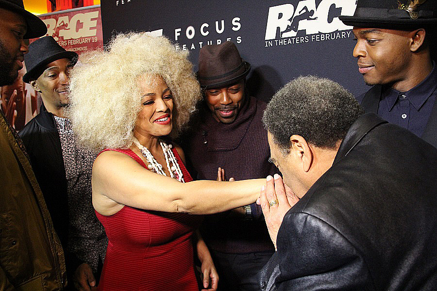 Ambassador Andrew Young kisses host Kim Field's hand at the Race movie premiere (Copyright photos taken by Terry Shropshire for Atlanta Daily World and Real Times Media).