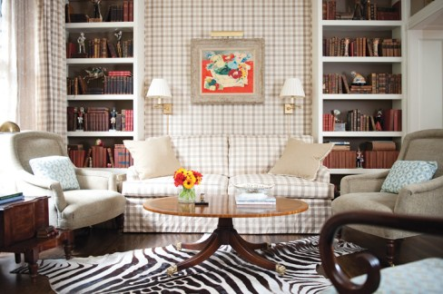 The zebra-skin rug in the couple's sitting room was picked up three years ago on a trip to Capetown, South Africa, and eagerly whisked home to the States, where Loughlin planned to use it at her mountain retreat. Instead, she opted to let it jazz up her condo's more traditional decor. High-contrast accents like these suit Loughlin's design philosophy well; she likes to add a little whimsy to every design. The blue floral Brunschwig & Fils fabric on the chairs was selected to pick up the colors in the exquisite Jean de Botton painting above the sitting room sofa.