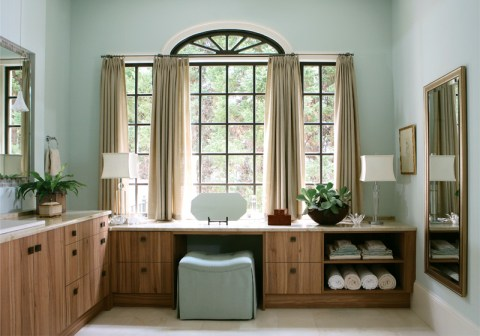 The room's focal point is undoubtedly the window wall. Dark-painted mullions draw your eye to the window and the long vanity beneath.
