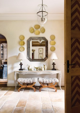 87) Heather Dewberry and Will Huff made a bold statement with the arrangement of understated plates in this foyer.