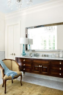 Decorative accents from The Mercantile, contribute to the comfortable feeling of this luxuriously spacious bathroom.