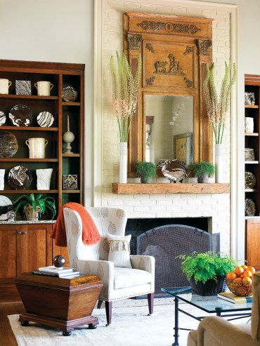 Over the fireplace, a circa-1850 French trumeau mirror commands attention.
