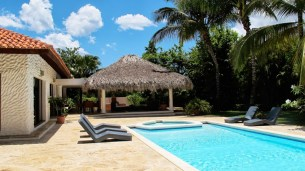 Outside Villa Toscana, a swimming pool, half-bath and a shaded gazebo with lounges and a dining table await.