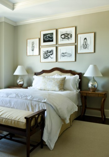 """Perhaps the most personal art in the house, drawings of shoes over the headboard in this guest room, were created by the owners"""" daughter when she was in college."""