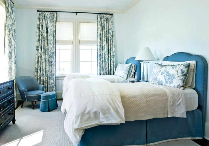 A second guest room, outfitted with twin beds, is decked out in a calming blue hue and punctuated with pattern, right down to the painted chest. All of the beds are dressed in linens from Gramercy Home.