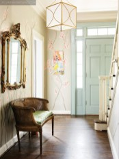 Hand-painted cherry blossoms adorn the walls of the foyer designed by Laura Green, making an enchanting first impression on visitors to Inspiration House.