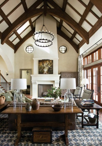 Designer Barbara Westbrook created interest in the family's great room by incorporating modern design elements into the architecture's traditional envelope, like a Paul Ferrante chandelier from Ainsworth-Noah & Associates and the John Folsom painting above the mantel.