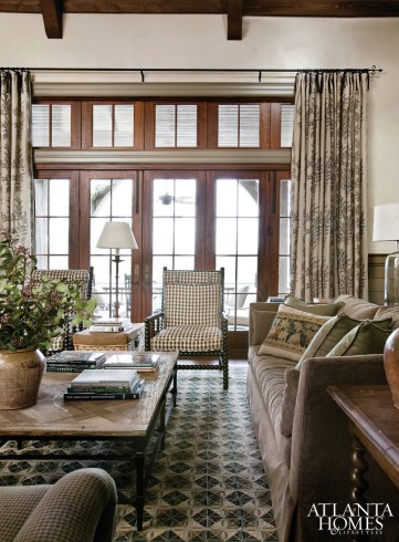 Classic design elements include the antique trestle table from Dearing Antiques, the woven area rug from Eve, Inc. and a pair of Formations Bobbin chairs from Jerry Pair & Associates.
