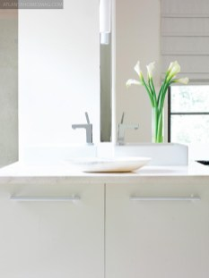ECO WITH AN EDGE In many ways, this bathroom is as sustainable as it is functional and beautiful. A Brac Grey Water Recycling System filters water from the shower and sink for use in the toilet, dramatically reducing water usage.