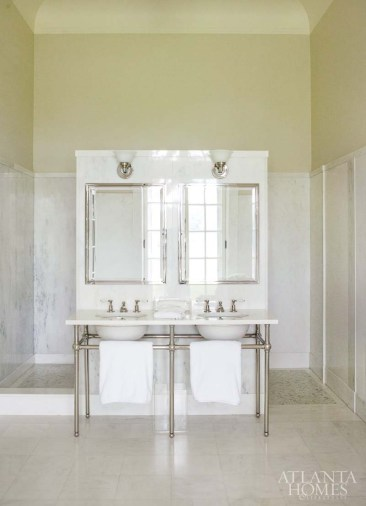 Their home, dating from the early 20th century, featured an exquisite use of marble, including this bathroom.