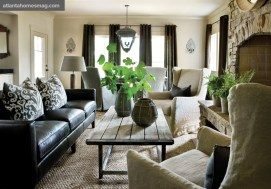Earthy ceramics abound in the main-level living space, where a classic leather sofa gets updated in a streamlined shape.