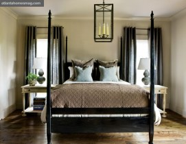 The master on main is inviting in its simplicity. Above the bed, an antique-look pendant casts a soft glow and—in combination with framed Greco-Roman scenes—harkens to a bygone era. Still, sleek gray gourd lamps and chocolate brown trellis-patterned pillows give the room a contemporary spin, while a pinched Paris concrete bowl serves as a conversation piece.