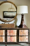 A vignette in an upstairs guest bedroom has loads of rustic style.