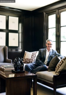 Designer Bob Brown sits among pieces from his new furniture collection with MacRae Designs: the upholstered settee and cocktail table with nesting tables underneath.