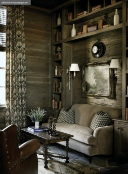 The cozy sitting room, with natural tones and interesting textures beckons with laid-back luxury; draperies in a Clarence House fabric add a light, feminine touch.