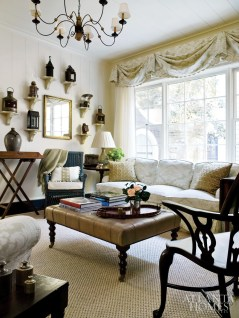 A grouping of antique lanterns in the family room lends a sculptural form to the cozy space.