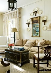 A collection of creamware is displayed artfully over a sofa.