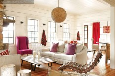 Against a backdrop of white, Douglass introduced bold and graphic pops of orange, purple and fuschia in the living room. Basket light, pillows and Verellen sofas and chairs, South of Market. The leather chaise was bought in France.