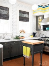 The Boomershines remodeled the kitchen when they purchased the house, yet kept it within the footprint of the original. Subway tile and marble countertops add a vintage feel.