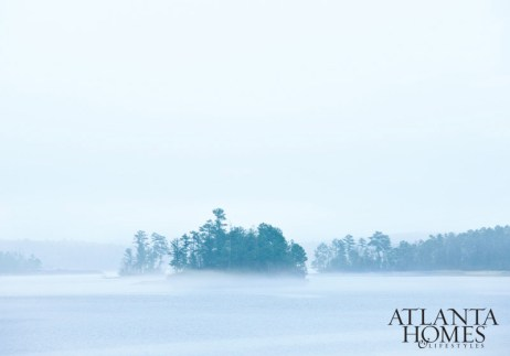 An early-morning fog rises above Lake Martin, Alabama, home to the weekend retreat designed by Susan Ferrier and Bobby McAlpine.