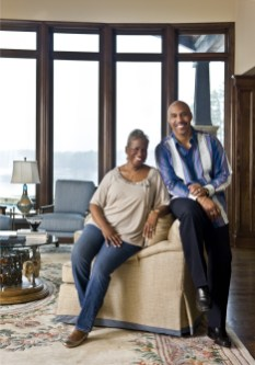 "The couple in the living room. ""This house was built for our retirement. We wanted to be able to live in it no matter how infirmed we got. We don""t ever have to go upstairs if we don""t want to. It""s designed to be low maintenance."""