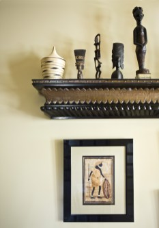 African artifacts line a shelf in the guest room that was given to the Pearsons by builder Ruben Calleiro.