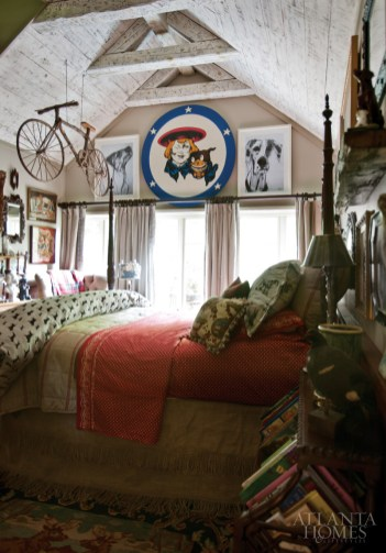 Another guest room features whimsical touches, including a bicycle suspended from the ceiling.