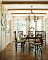 The breakfast area opens onto a cutting garden with a fountain, while a pair of custom paneled doors conceals the wife's office.