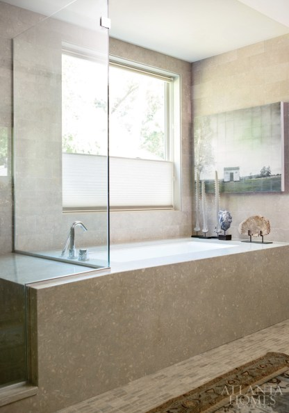 A large window in the master bath allows natural light to flood the sybaritic space throughout the day.