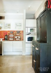 As the owners of Traditions in Tile and Stone, Ann and Warner Veal had access to exquisite materials. Still, they give credit to the company's own Jack Hughes for the tile design throughout the house—including the red glass-tiled backsplash in the kitchen.