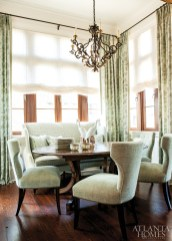 """The dining room is a very small space so you really notice every detail,"" says Weaks. ""We had to capitalize on every square inch of it."" The banquette was custom made for the alcove by Edward Ferrell + Lewis Mittman and upholstered in a Henry Calvin fabric, both from Ainsworth-Noah & Associates. The dining table is by New Classics Creations, and the chairs are by Edward Ferrell + Lewis Mittman. Iron-and-gilt chandelier, Robuck & Company."