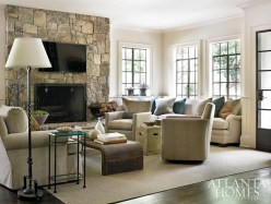 In the family room, Kay and Hooff removed built-in benches that distracted from the metal windows and took up precious space. In its place, the designers filled the expanded corner with a sectional sofa from Brice Ltd. The swivel chairs are from Smith Grubbs & Associates.