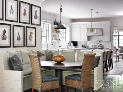 In the breakfast nook, mounted hooks keep the cushions from budging. The steel breakfast table is from South of Market, and the banquette fabrics are Perennials and Classic Arts.