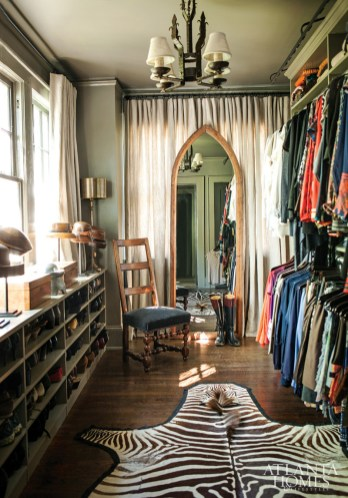 """To increase closet space in the circa-1920s house, Prillaman and Ferrier transformed a former sleeping porch into an organized space for her color-coordinated wardrobe, shoes, collection of hat stands and more. """"I think of clothing as a backdrop for shoes and jewelry,"""" says Prillaman of her personal style. """"The larger and more unique the jewelry is, the happier I am."""""""