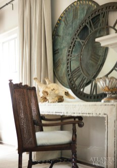 Antique clock faces rest atop a hide-covered console in the living room.