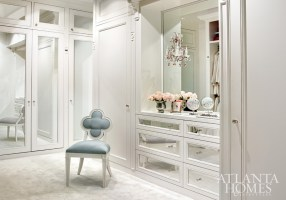 Glamour is key in Kasler's private dressing room, outfitted with mirrored panels and an Alexandra quatrefoil chair of her own design.
