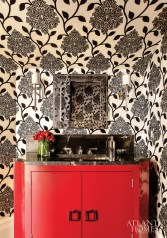 4. A marble-topped red-lacquer vanity and manuel canovas wallcovering are super-chic in a Barbara Westbrook-designed powder room.