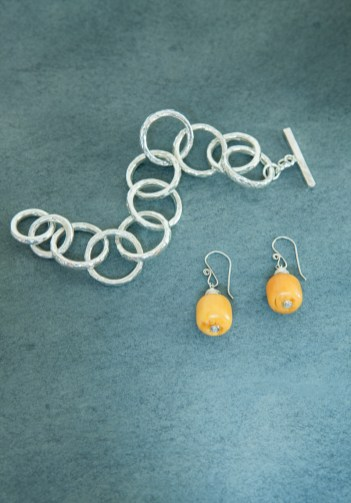 Jewelry selections include a bracelet by Cary Calhoun Designs and earrings by Frances Smith.