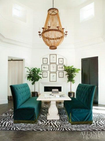 In the conference room, two fiddle leaf figs flank the fireplace and bring the room back to human scale.